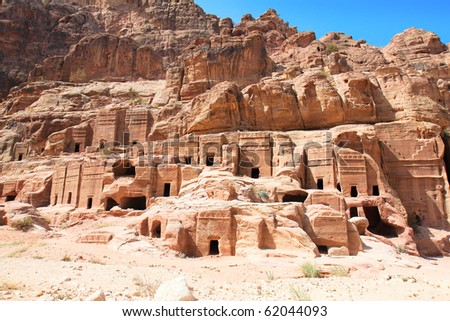 Street of Facades, riddling the walls of the Outer Siq are over 40 tombs and houses built by the Nabataeans. Ancient city of Petra, Jordan. It is now an UNESCO World Heritage Site. Petra, Jordan - stock photo