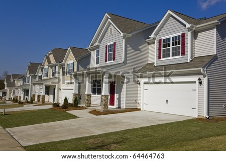 Street of new affordable houses - stock photo