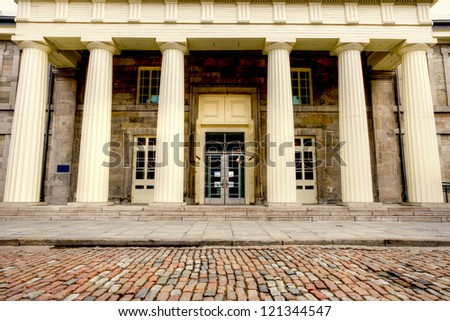 Street of Old Montreal, and in the background the facade of a building with columns, HDR image - stock photo