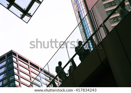 Street photography in Tokyo, detail of the architecture and unidentifiable silhouettes figures in the Ginza business district. Negative space for text.  - stock photo