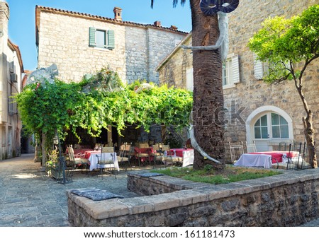 Street restaurant in old town of Budva, Montenegro - stock photo