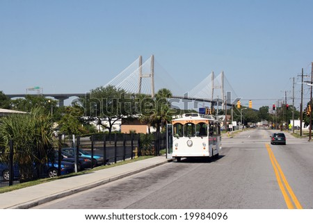 Street scene in Savannah, Georgia with the Talmadge memorial bridge in the background. - stock photo