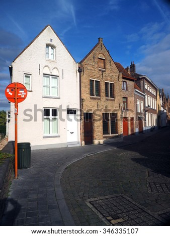 street scene medieval buildings houses offices condos in historic Bruge Brugges Belgium        - stock photo
