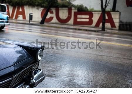Street scene on rainy day in Havana,Cuba - stock photo