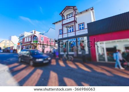 Street scene street in downtown Reykjavik, Iceland, leading to the Hallgrimskirkja Church, one of the landmarks of the city. - stock photo