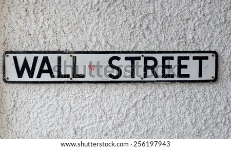Street sign for Wall Street in small UK town - stock photo