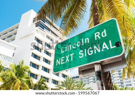 Street sign marking directions to Lincoln Road, a famous dining and shopping boulevard in Miami Beach - stock photo