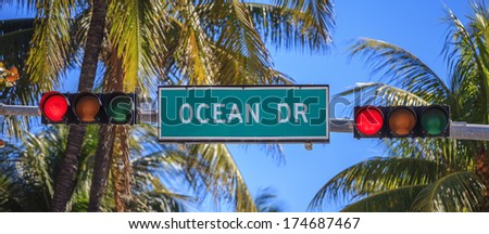 street sign of street Ocean Drive in Miami South with traffic light  - stock photo