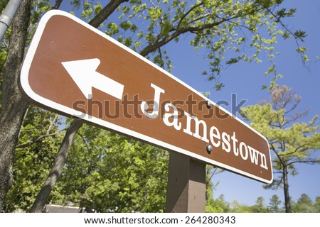 Street sign pointing to Jamestown Settlement in Colonial Williamsburg, Virginia, the site of the 1607 English Colony - stock photo