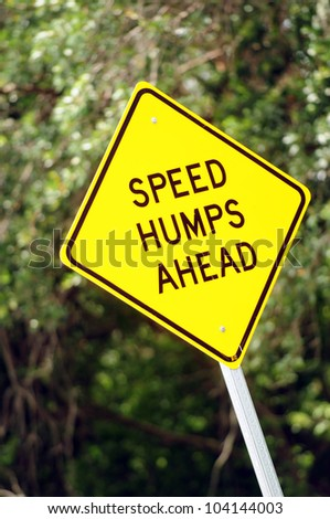 street sign that says speed humps ahead - stock photo