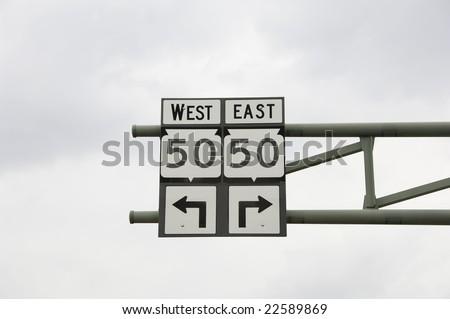 Street sign: turn left? turn right? Decisions, decisions . . . Main Street, Lake Geneva, Wisconsin, June 2008 - stock photo