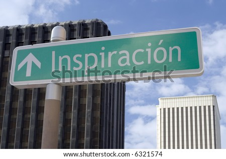 "Street sign with an arrow and the Spanish word ""inspiracion"" located in a business district - stock photo"