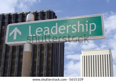 "Street sign with an arrow and the word ""leadership"" located in a business district. - stock photo"