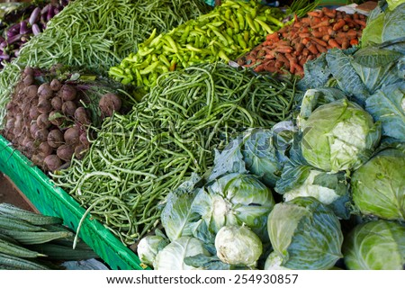Street vegetable vendor at Sri-lanka sells a wide range of vegetables - stock photo