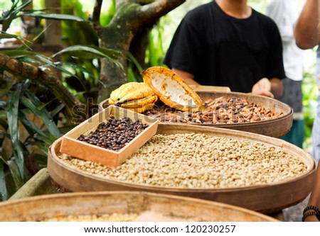 Street vendor selling a variety of dried legumes and vegetables laid out in round flat baskets on a table - stock photo
