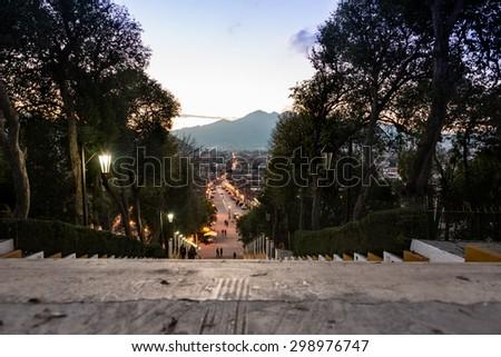 Street view and sidewalk on San Cristobal de las Casas colonial town. Latin American Culture. - stock photo