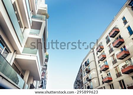 street view in berlin kreuzberg  with modern residential houses - stock photo
