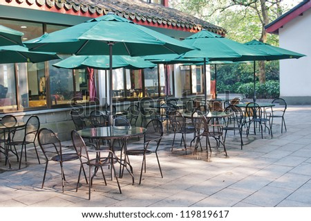 Street view of a coffee terrace with tables and chairs - stock photo