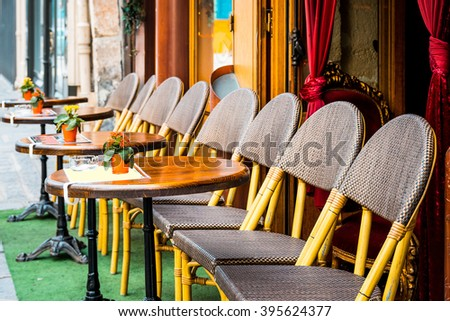 Street view of a coffee terrace with tables and chairs in europe. - stock photo
