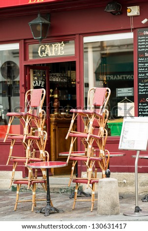 Street view of a coffee terrace with tables and chairs,paris France - stock photo
