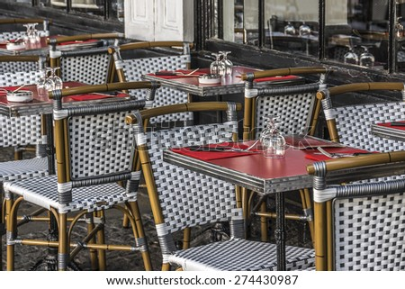 Street view of a typical outdoor coffee terrace with tables and chairs near Centre Georges Pompidou. Paris. - stock photo