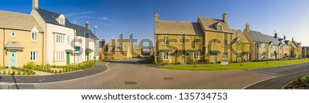 Street view of newly built homes. - stock photo