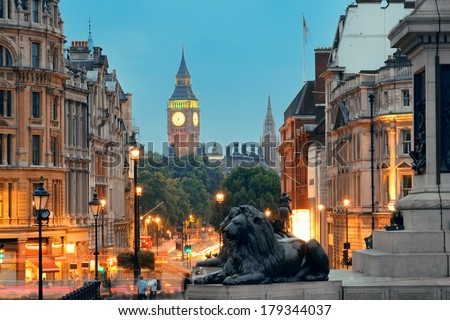 Street view of Trafalgar Square at night in London - stock photo