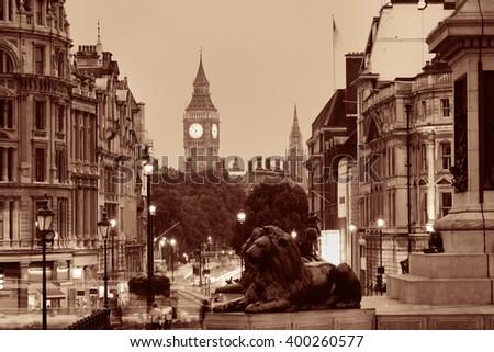 Street view of Trafalgar Square at night in London in BW - stock photo