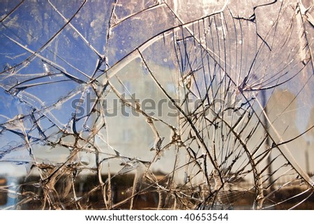 Street view throw window with broken glass - stock photo