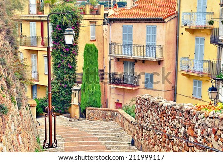 Street with buildings and paved brick walkway in Cannes, France - stock photo