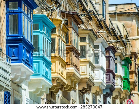 street with colorful balconies in historical part of Valletta in Malta - stock photo