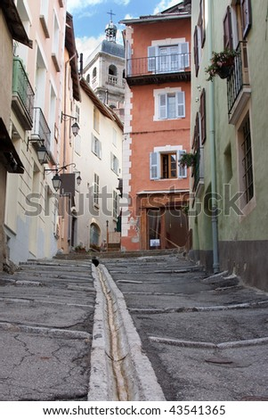 Street with gutter in the historic center of Briancon, France - stock photo