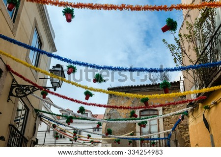 Street with holiday decoration during Lisbon Festival (Festas de Lisboa) in Portugal - stock photo