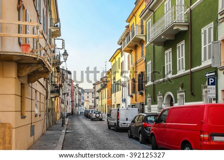 Street with many colorful historical houses in Parma, Emilia Romagna province, Italy. - stock photo
