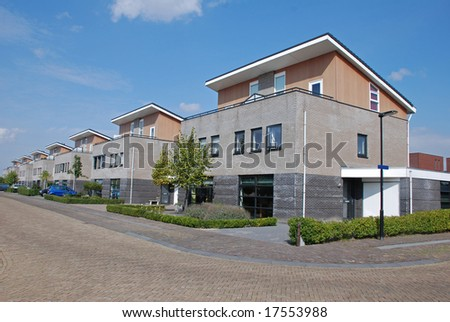 Street with modern family houses - stock photo
