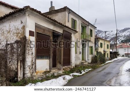 Street with old houses in Antartiko village, Florina, Greece - stock photo