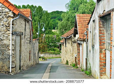 Street with traditional houses in Champagne-Ardenne region of France - stock photo