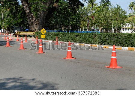 Street with traffic cone - stock photo