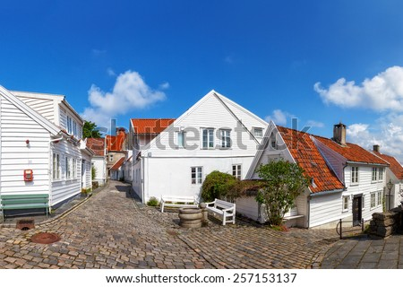 Street with white houses in the old part of Stavanger, Norway - stock photo