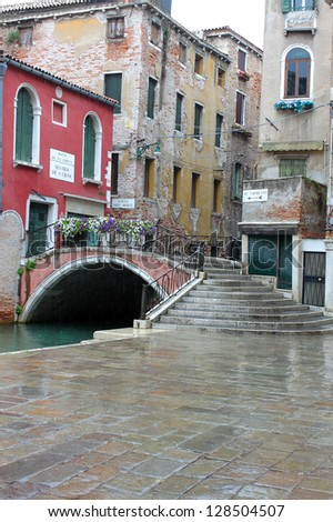 Streets and canals of Venice in the rain - stock photo