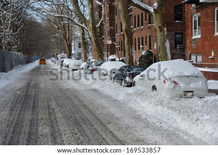 Streets in Brooklyn is seen after the seasons first snow storm in NYC - stock photo