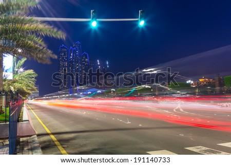 Streets of Abu Dhabi at night, capital of United Arab Emirates - stock photo