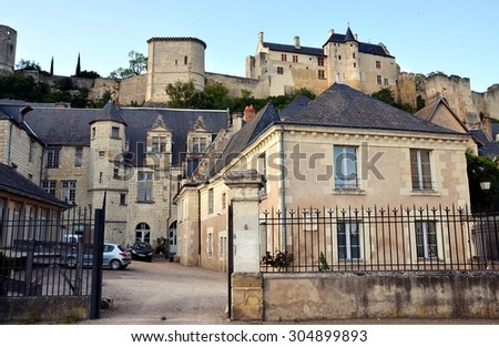 Streets of Chinon city with old stone buildings and view on the castle, France - stock photo