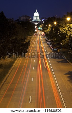 Streets of Madison, Wisconsin seen evening time. State Capitol Builidng in the back. - stock photo