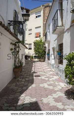 streets of Marbella in Spain with flowers and plants on the facade - stock photo