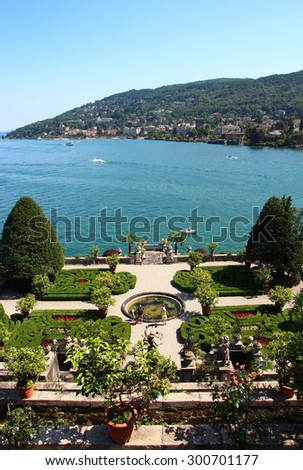 STRESA, ITALY - JUNE 7, 2015: the beautiful view of Maggiore lake from the Italian Gardens at the Isola Bella - stock photo