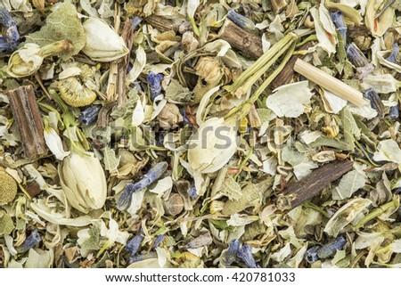 stress and anxiety herbal tea with lavender, chamomile, chrysanthemum, jasmine, lemon balm and Buddha tea - closeup background - stock photo