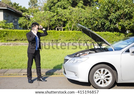 stress business man calling for help with  car broken concept - stock photo