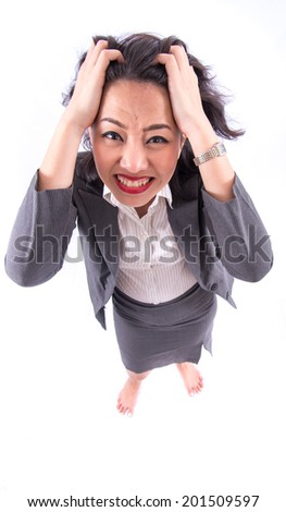 Stress. Business woman frustrated and stressed pulling her hair.  - stock photo