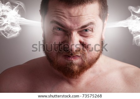 Stress concept. Angry upset stressed man with head pressure - stock photo